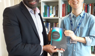 Dapo Akande and Jack McNichol (OUP) with the book 'Human Rights and 21st Century Challenges'